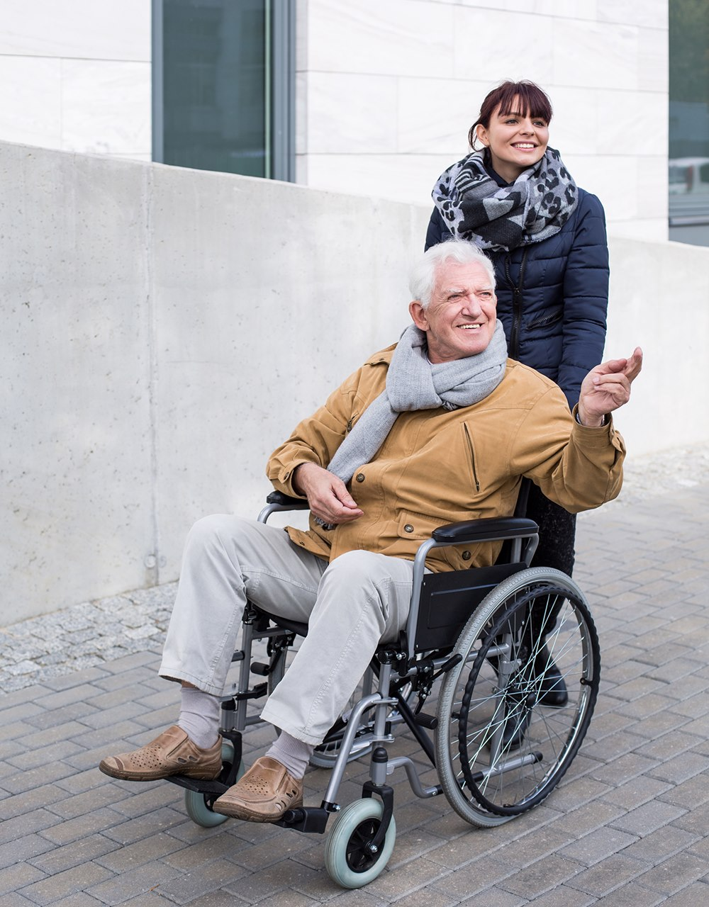 Image of Man in wheelchair and woman helping him